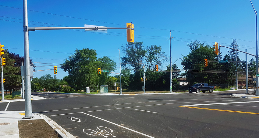 Re-opened intersection of Dominion and Northwood with bike lane in foreground