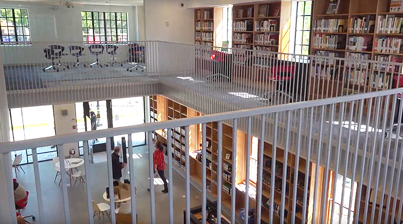 Open concept library space viewed from second floor