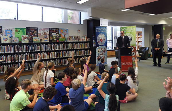 Mayor Drew Dilkens and Ward Councillor Ed Sleiman with students from David Maxwell Public School at Seminole Library