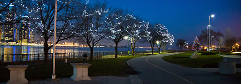 Trees lit along riverfront path