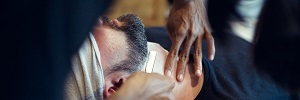 Barber shaving client's neck