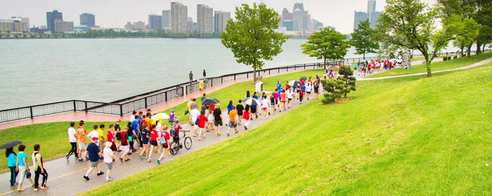 Walkers along the riverfront path