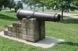 Historic cannon in a park.