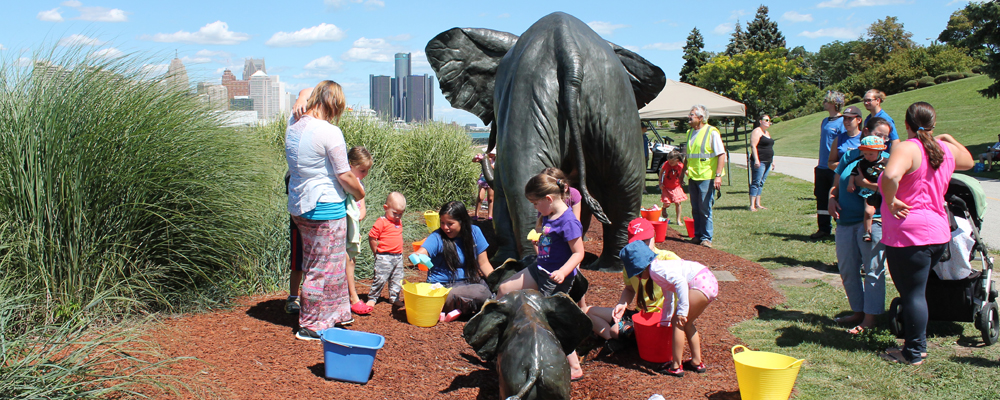 Children wash the Tembo sculpture at the Windsor Sculpture Park