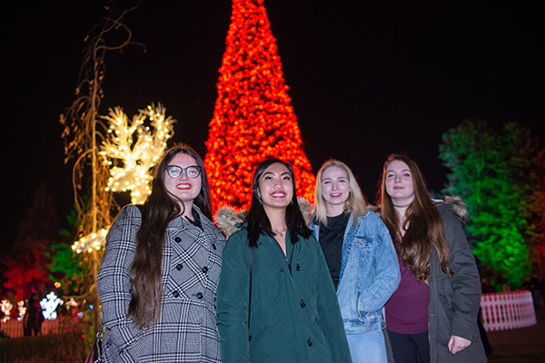 Friends pose in front of the central tree