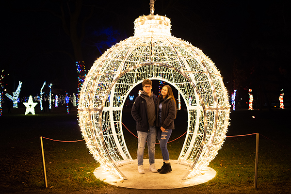 Couple in a giant tree bulb