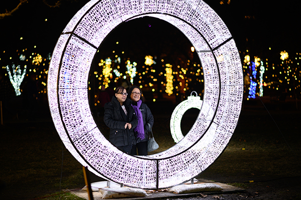 Ladies look through a white light ring