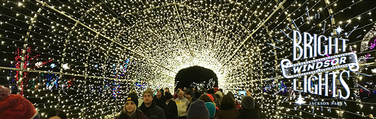 Visitors walk through the light tunnel at Bright Lights Windsor