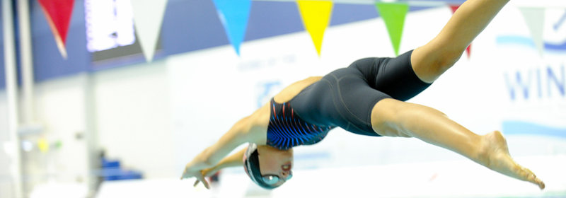 Swimmer dives into the WIATC Pool