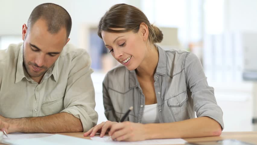Man and woman filling out a form