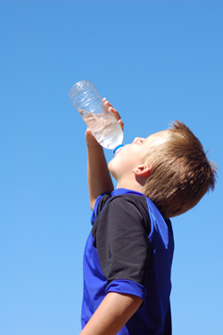 Boy drinking a bottle of water