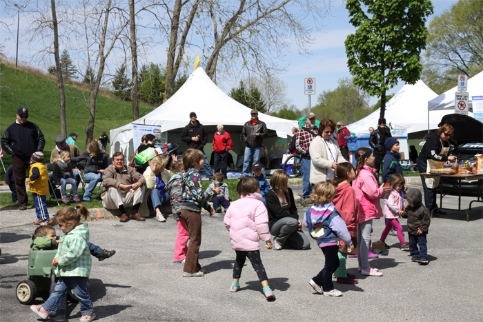 Kids and families enjoying Earth Day booths