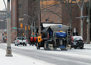 Salt truck on a downtown street