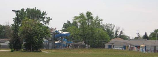 a landscape view of the Booster Pool and surrounding trees at the Remington Booster Park