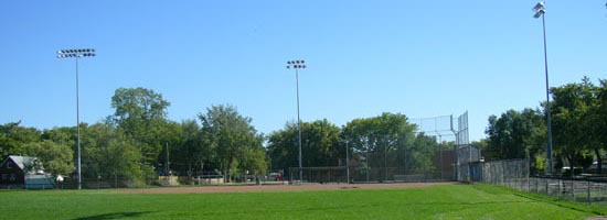 a landscape view of a baseball diamond at the Riverside Baseball Park