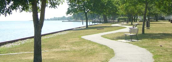 a shot of a walking trail off of the water, at Sandpoint Park