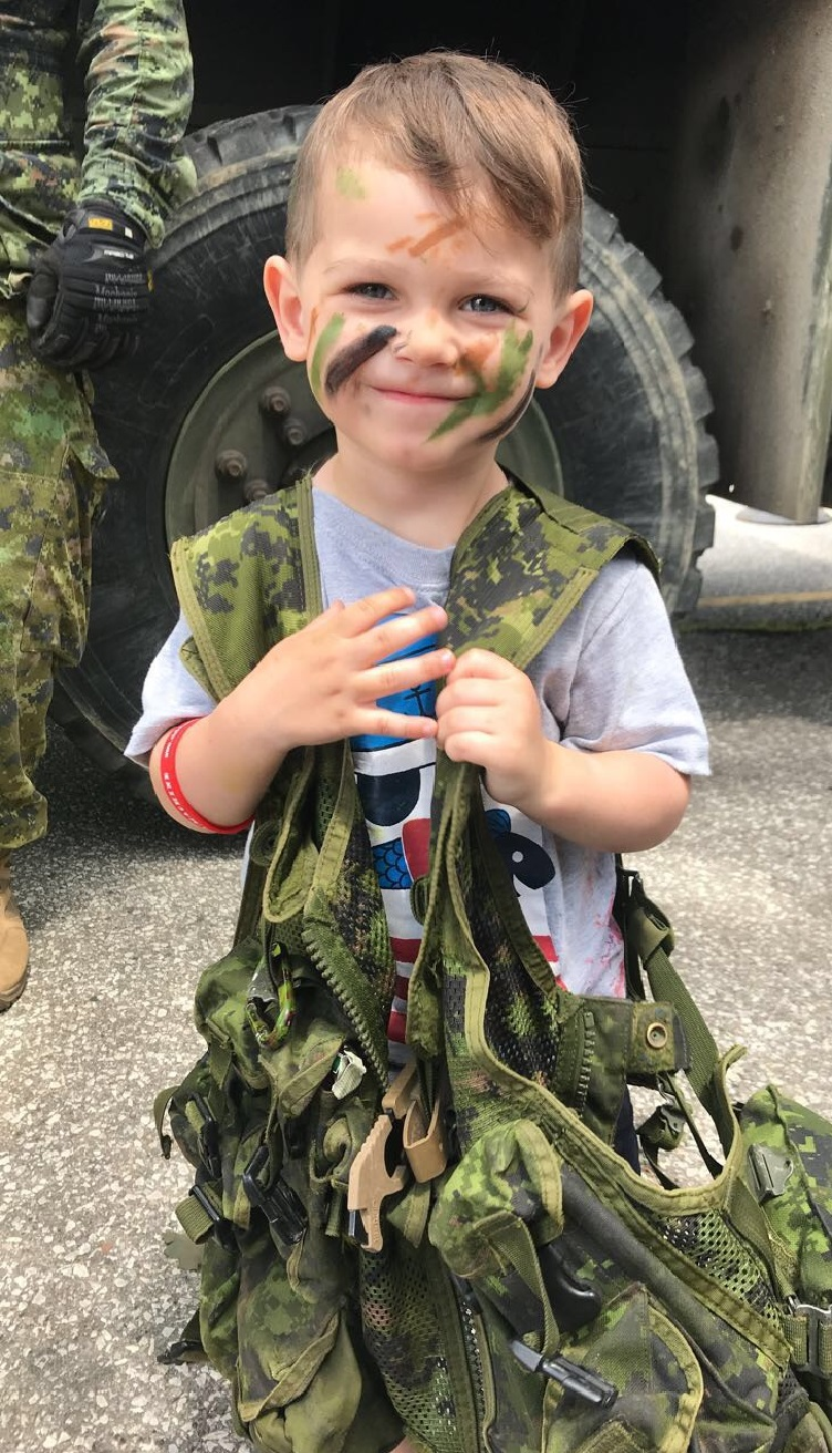 Boy with army vest and face paint