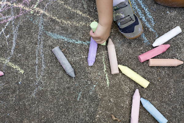Chalk pencils on pavement