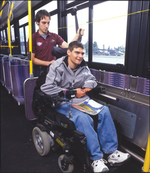 Bus driver helps a patron in a wheelchair